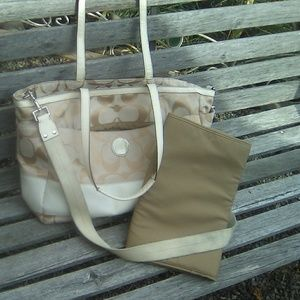Coach diaper bag and changing mat